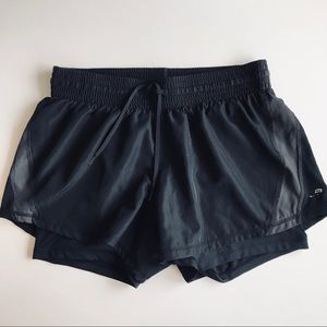 Black Champion running shorts with built in slides